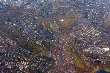 fluvial: Aerial view of suburban area Dusseldorf, Germany, Europe, with mixed residential and industrial zones.