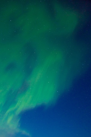 ionosphere: Clear night sky with lots of stars and dancing northern lights (Aurora borealis). Stock Photo