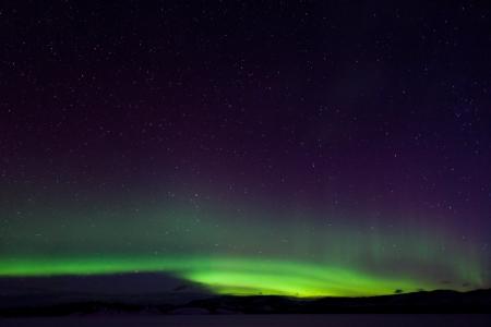aurora borealis: Colorful northern lights (aurora borealis) substorm on dark night sky with myriads of stars. Stock Photo