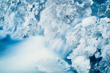 solidify: Small creek freezing up at -40 below. Stock Photo