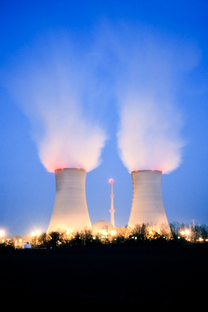 Nuclear power plant blowing huge clouds into dusky sky. Stock Photo - 14145181