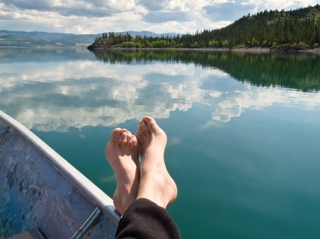 Relaxing in motorboat drifting on calm Lake Laberge, Yukon Territory, Canada. photo