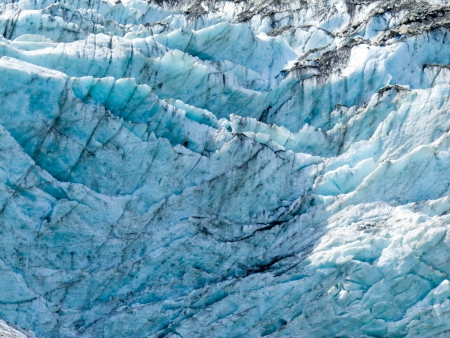 Blue turquoise glacier icefall frozen ice background texture pattern