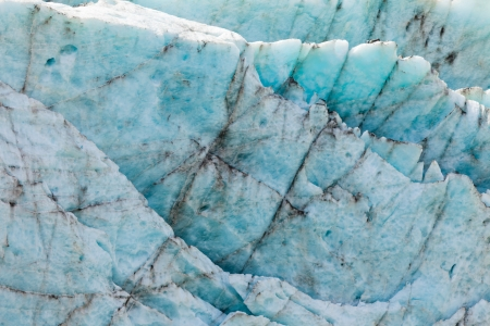 icescape: Blue turquoise glacier icefall frozen ice background texture pattern