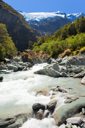 aspiring: Beautiful glacial river running off hanging Rob Roy Glacier in Mount Aspiring National Park, Southern Alps, New Zealand