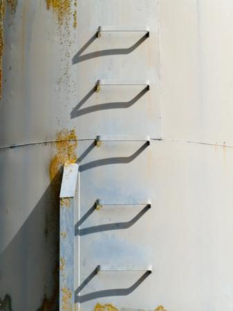 Iron ladder steps of metal fodder fermenting silo storage tank photo