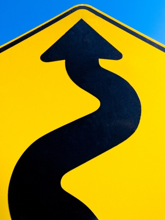 Wavy arrow on road sign pointing upward in a concept of achievement, advancement and success Stock Photo