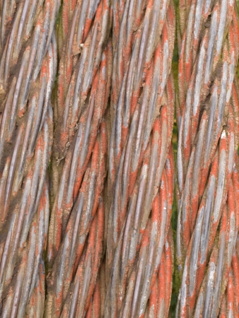 rusty background: Background texture pattern of old rusty stranded steel cable Stock Photo