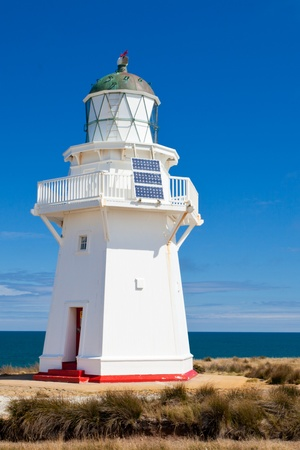 newzealand: Beautifully restored heritage building of Wairapa Point Lighthouse on The Catlins coast on South Island of New Zealand Stock Photo