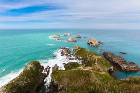 Beautiful rugged rocky coastline of Nugget point in the Catlins on South island of New Zealand photo