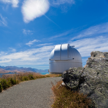 observations: Domed astronomy observatory building housing a telescope for astronomical and meteorological observations standing on a mountain top to afford a clear view Editorial