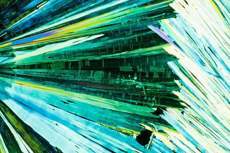 urea: Colorful apearence of crystals of urea or carbamid, a powerful nitrogen fertilizer for agricultural use, in polarized light.
