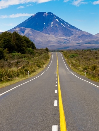 active volcano: Straight highway leading to active volcano cone of Mount Ngauruhoe in Tongariro National Park, North Island of New Zealand Stock Photo