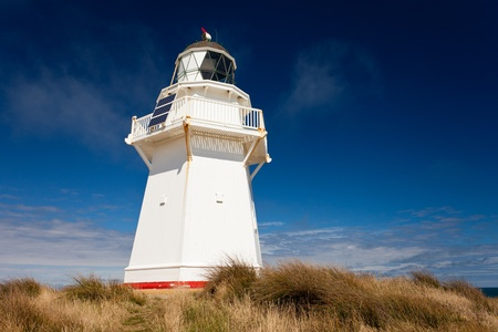 Beautifully restored heritage building of Waipapa Point Lighthouse on The Catlins coast on South Island of New Zealand photo