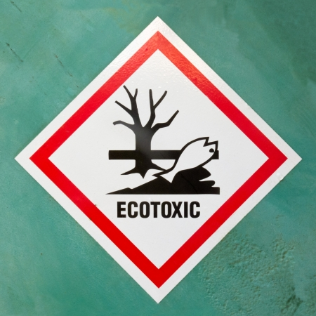 dead fish: Dangerous for the environment hazard symbol or ecotoxic warning sign on a painted wall warning of lethal consequences to plant and animal life due to toxicity Stock Photo