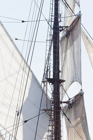 three masted: Marine or nautical background of a three masted barquentine yacht with sails and rigging detail Stock Photo