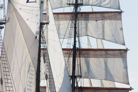 Marine or nautical background of a three masted barquentine yacht, square rigged on the foremast, with sails and rigging detail photo