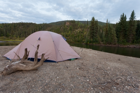 boreal: Tent pitched on a sand bar alongside McQuesten River, Yukon Territory, Canada, in remote boreal forest wilderness