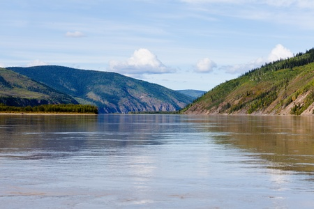 yukon territory: Boreal forest hills at river bank of Yukon River, Yukon Territory, Canada, near Dawson City forming a beautiful northern riverscape.