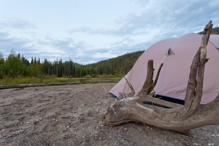 Tent pitched on a sand bar alongside McQuesten River, Yukon Territory, Canada, in remote boreal forest wilderness Stock Photo - 15704220