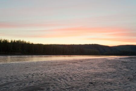 river bank: Sunset twilight over boreal forest at Yukon River, Canada