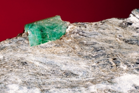 mineralized: Rare emerald raw precious gemstone on matrix rock, an expensive variety of beryl  Birthstone for May and starstone associated with Taurus and Cancer