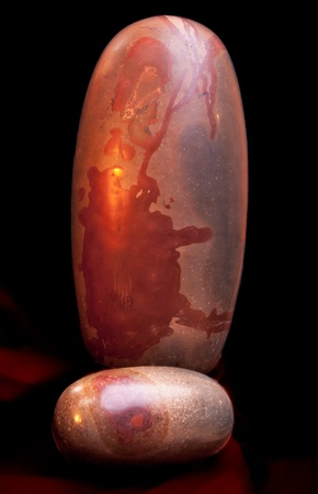 worshipped: Tantric Lingam stone, Cosmic Eggs, from Narmada River in India are one of the oldest religious symbols of human civilization  They are naturally tumbled and pre-shaped by the river  Stock Photo