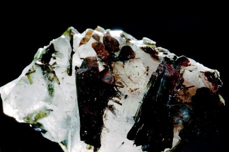 green tourmaline: Turmaline semiprecious gemstone inclusions in quarz matrix  Birthstone for October