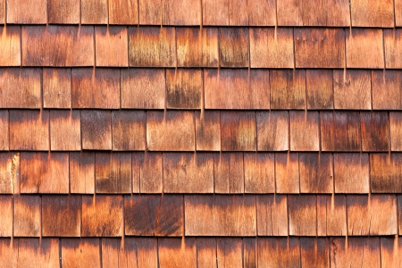 cedar: Westen red cedar shingles background texture pattern makes a natural organic wooden wall siding for residential buildings Stock Photo