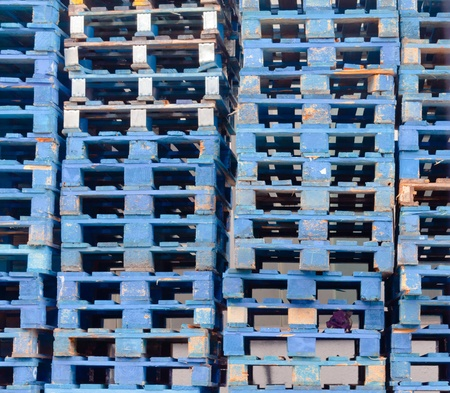 batch of euro: Stack of piled blue rough wooden euro pallets background texture pattern Stock Photo
