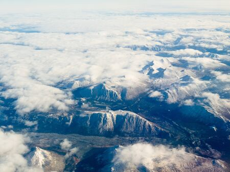 Aerial view of snowcapped mountains in northern part of the province of beautiful British Columbia, Canada  版權商用圖片