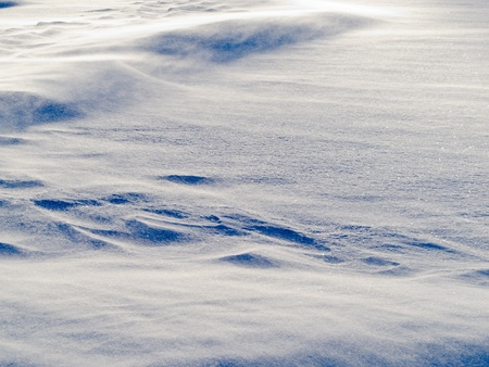 drifting ice: Blizzard background texture pattern  drifting snow crystals driven by strong wind creating snow surface refief Stock Photo