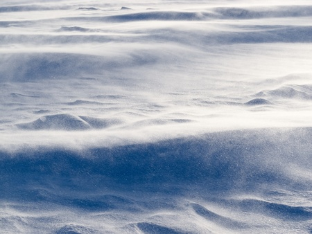 driven: Blizzard background texture pattern  drifting snow crystals driven by strong wind creating snow surface refief Stock Photo
