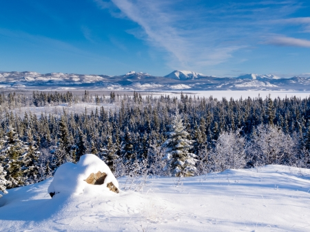 Beautiful winter wilderness landscape of frozen Lake Laberge  Yukon Territory  Canada photo