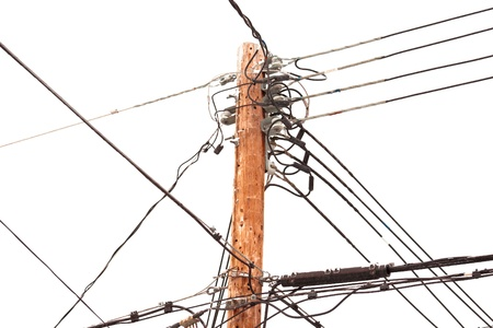power cables: Utility pole hung with electricity power cables for residential supply