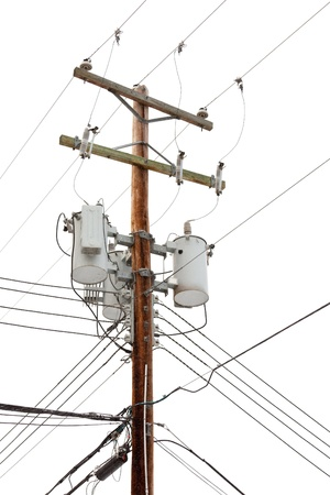 Utility pole hung with electricity power cables and transformers for residential supply Stock Photo
