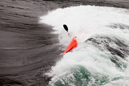 Kayaker capsizing white whitewater kayaking enjoying the extreme thrill of paddling fast currents  breaking waves and wild water Stock Photo - 18496981