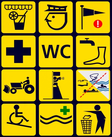 tractor warning sign: Sign with 12 instuctional symbols  black on yellow  for popular ocean beach swimming