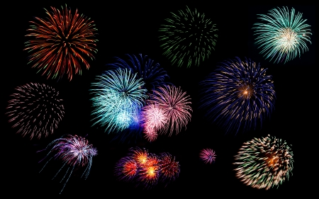 Collection of colorful festive fireworks  sparklers  salute and petards explosions isolated over black night sky background as design elements Stock Photo