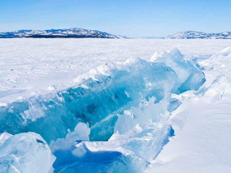 yukon: Large chunks of ice pushed upwards in a pressure ridge on wintery frozen Lake Laberge  Yukon Territory  Canada