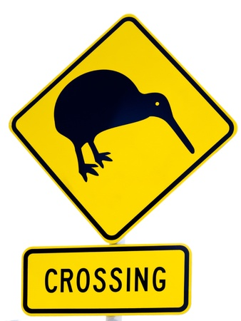 ratite: New Zealand Road Sign: Attention Kiwi Crossing isolated on white background Stock Photo