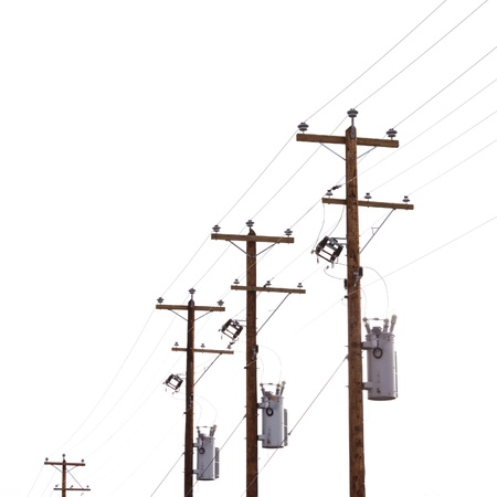 Row utility poles hung with electricity power cables and transformers for residential electric power supply isolated on white background photo