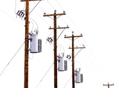power cables: Row utility poles hung with electricity power cables and transformers for residential electric power supply isolated on white background