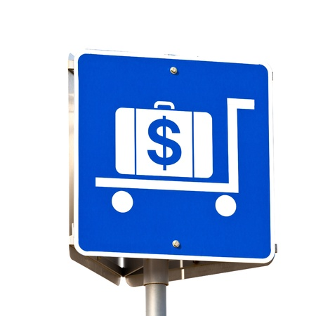 payable: Sign for hiring luggage trolleys at a travel terminal with a pictogram of a suitcase on the trolley with a large dollar sign on it Stock Photo