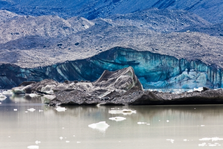 water frozen: Tasman Glacier ends at Lake with floating icebergs in Aoraki Mount Cook National Park on South Island of in New Zealand