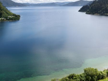 mirrored: Mirrored clouds on calm surface of Lake Waikaremoana in Urewera National Park in Hawke