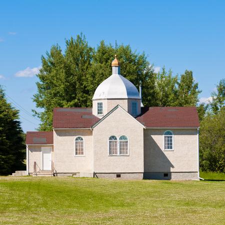 congregation: Small Ukrainian orthodox christian church edifice building in Prairies of Alberta  Canada Stock Photo