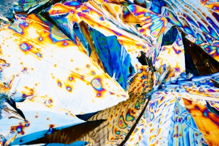 polarization: Colorful appearance of crystals of tartaric acid, one of many compounds found in grapes and wine, in polarized light.