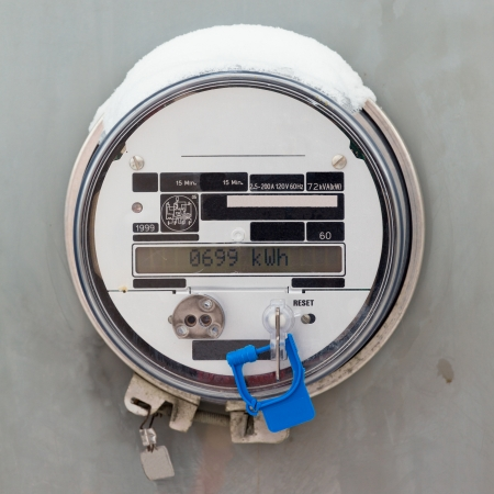 Modern smart grid residential digital power supply meter displays kilowatthours of consumed electric energy