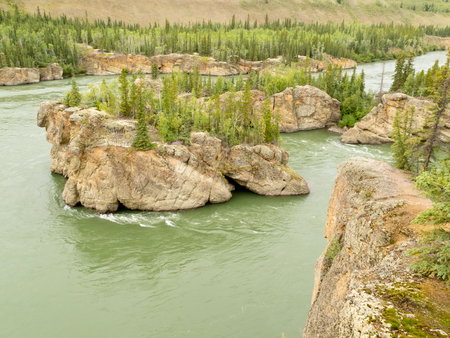 treacherous: Treacherous Rock islands of Five Finger Rapids in Yukon River near town of Carmacks, Yukon Territory, Canada Stock Photo